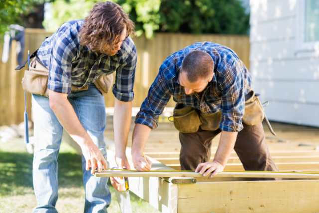 Building a Deck in Salem by 2 workers with tool belts