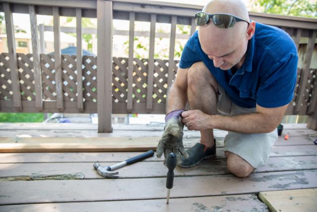 Deck Repair by Salem worker with power tool