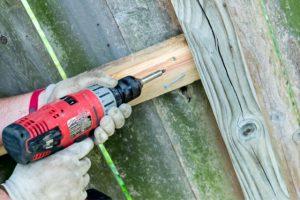 Fence Repair in Salem by worker