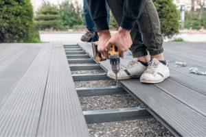 Worker Installing Composite Deck in Salem