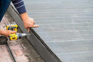 Salem worker installing composite deck