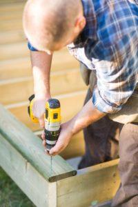 Salem Deck Contractor screwing in wooden deck