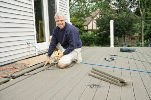 Salem Deck Installation with worker and tools