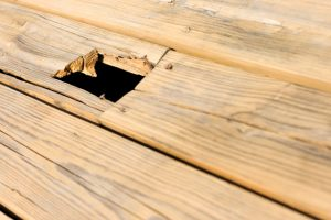 Salem Deck Repair with hole in the wood