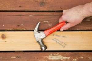 Salem Deck Repair with hammer and nails