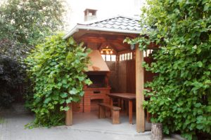Salem Wooden Gazebo with firepit and eating bench and table
