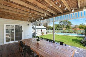 Salem residential backyard wooden deck and pergola