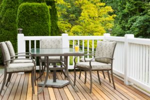 Salem residential cedar wood deck with a lot of greenery around the yard
